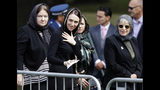 New Zealand Prime Minister Jacinda Ardern, center, leaves Friday prayers at Hagley Park in Christchurch, New Zealand, Friday, March 22, 2019. People across New Zealand are observing the Muslim call to prayer as the nation reflects on the moment one week ago when 50 people were slaughtered at two mosques. (AP Photo/Mark Baker)