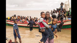 In this photo supplied by the Red Cross Red Crescent Climate Centre survivors of Cyclone Idai arrive by rescue boat in Beira, Mozambique, Thursday, March 21, 2019. The confirmed death toll in Mozambique, Zimbabwe and Malawi surpassed 500, with hundreds more feared dead in towns and villages that were completely submerged. (Photo -Denis Onyodi - Red Cross Red Crescent Climate Centre via AP)