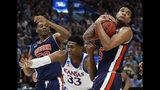 Auburn blows past Kansas 89-75 to reach Sweet 16