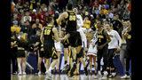 Iowa forward Luka Garza (55) and teammates celebrates after a first-round game against Cincinnati in the NCAA men's college basketball tournament, Friday, March 22, 2019, in Columbus, Ohio. Iowa won 79-72. (Kareem Elgazzar/The Cincinnati Enquirer via AP)