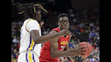 Maryland's Jalen Smith, right, looks for a shot against LSU's Naz Reid during the first half of a second-round game in the NCAA men's college basketball tournament in Jacksonville, Fla., Saturday, March 23, 2019. (AP Photo/John Raoux)