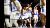 UCLA's Lauryn Miller (33), Shayley Harris (25) and Eliana Sigal (51) gesture after teammate Japreece Dean scored a 3-pointer in the first half of a first-round game against Tennessee in the NCAA women's college basketball tournament, Saturday, March 23, 2019, in College Park, Md. (AP Photo/Patrick Semansky)