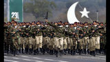 Pakistani commandos from the Special Services Group march during a military parade to mark Pakistan National Day, in Islamabad, Pakistan, Saturday, March 23, 2019. Pakistanis are celebrating their National Day with a military parade that's showcasing short- and long-range missiles, tanks, jets, drones and other hardware. (AP Photo/Anjum Naveed)