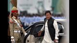Pakistani Prime Minister Imran Khan arrives to attend a military parade to mark Pakistan National Day, in Islamabad, Pakistan, Saturday, March 23, 2019. Pakistanis are celebrating their National Day with a military parade that's showcasing short- and long-range missiles, tanks, jets, drones, and other hardware. (AP Photo/Anjum Naveed)