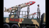 A Pakistani-made Cruise missile Ra'ad is loaded on a trailer rolls down during a military parade to mark Pakistan National Day, in Islamabad, Pakistan, Saturday, March 23, 2019. Pakistanis are celebrating their National Day with a military parade that's showcasing short- and long-range missiles, tanks, jets, drones and other hardware. (AP Photo/Anjum Naveed)
