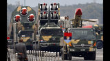 Pakistani-made missiles are loaded on a trailers roll down during a military parade to mark Pakistan National Day, in Islamabad, Pakistan, Saturday, March 23, 2019. Pakistanis are celebrating their National Day with a military parade that's showcasing short- and long-range missiles, tanks, jets, drones and other hardware. (AP Photo/Anjum Naveed)
