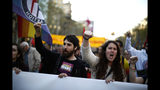 People shout slogans during a protest against the emergence of a far right party in Spain ahead of next month's national elections in Barcelona, Spain, Saturday, March 23, 2019. Spain hadn't had a far-right party for years until Vox erupted onto the political scene by winning representation in regional elections in the country's south in December. (AP Photo/Manu Fernandez)