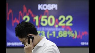 Global shares stumble following retreat on Wall Street