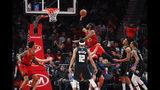 Atlanta Hawks forward DeAndre' Bembry (95) shoots in the first half of an NBA basketball game against the Milwaukee Bucks on Sunday, March 31, 2019, in Atlanta. (AP Photo/Todd Kirkland)