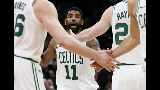 f0f859830fda Boston Celtics  Kyrie Irving is greeted by teammates after making the  game-winning shot against the Indiana Pacers in an NBA basketball game  Friday