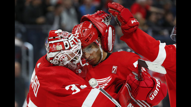49c34981a Detroit Red Wings goaltender Jimmy Howard, left, and Andreas Athanasiou  celebrate the team's 4-0 win against the New Jersey Devils in an NHL hockey  game ...