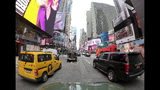 Motorists roll south on 7th Avenue in Times Square, Friday, March 29, 2019, in New York. Long ringed by some of the most expensive toll roads in the U.S., New York City is poised to take things even further with a plan to use automated license plate readers to charge drivers who motor into the most congested parts of Manhattan during times when crosstown traffic is at its worst.(AP Photo/Julie Jacobson)