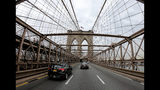 Motorists cross over the Brooklyn Bridge heading west into Manhattan, Friday, March 29, 2019, in New York. Long ringed by some of the most expensive toll roads in the U.S., New York City is poised to take things even further with a plan to use automated license plate readers to charge drivers who motor into the most congested parts of Manhattan during times when crosstown traffic is at its worst.(AP Photo/Julie Jacobson)