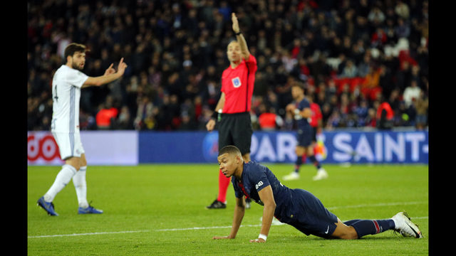 ef4866e53c00 PSG s Kylian Mbappe gets up from the floor during the French League One  soccer match between Paris-Saint-Germain and Strasbourg at the Parc des  Princes ...