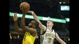 Milwaukee Bucks' Khris Middleton is fouled as he shoots by Atlanta Hawks' Kevin Huerter during the second half of an NBA basketball game Sunday, April 7, 2019, in Milwaukee. (AP Photo/Aaron Gash)