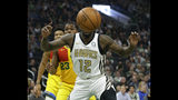Atlanta Hawks' Taurean Prince (12) watches as the ball bounces out of bounds during the first half of an NBA basketball game against the Milwaukee Bucks Sunday, April 7, 2019, in Milwaukee. (AP Photo/Aaron Gash)