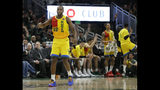 Milwaukee Bucks' Khris Middleton reacts after making a shot during the second half of an NBA basketball game against the Atlanta Hawks Sunday, April 7, 2019, in Milwaukee. (AP Photo/Aaron Gash)