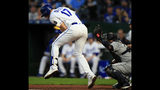 Kansas City Royals Hunter Dozier (17) is hit by a pitch from Seattle Mariners starter Felix Hernandez during the first inning of a baseball game at Kauffman Stadium in Kansas City, Mo., Monday, April 8, 2019. (AP Photo/Orlin Wagner)