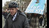 Britain's MP Boris Johnson arrives at the Houses of Parliament, in London, Wednesday March 27, 2019. British lawmakers are preparing to vote Wednesday on alternatives for leaving the European Union as they seek to end an impasse following the overwhelming defeat of the deal negotiated by Prime Minister Theresa May. (Dominic Lipinski/PA PA via AP)