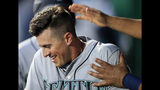 Seattle Mariners' Dylan Moore is congratulated by a teammate following his solo home run during the first inning of a baseball game against the Kansas City Royals at Kauffman Stadium in Kansas City, Mo., Monday, April 8, 2019. (AP Photo/Orlin Wagner)