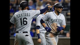 Seattle Mariners' Edwin Encarnacion, right, is congratulated by teammate Domingo Santana (16) after his three-run home run during the sixth inning of a baseball game against the Kansas City Royals at Kauffman Stadium in Kansas City, Mo., Monday, April 8, 2019. It was the second home run of the inning for Encarnacion. (AP Photo/Orlin Wagner)