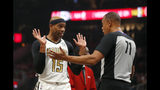 Atlanta Hawks forward Vince Carter (15) argues with referee Rodney Mott (71) in the first half of an NBA basketball game Wednesday, April 10, 2019, in Atlanta. (AP Photo/John Bazemore)