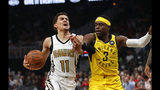 Atlanta Hawks guard Trae Young (11) is fouled by Indiana Pacers guard Aaron Holiday (3) in the first half of an NBA basketball game Wednesday, April 10, 2019, in Atlanta. (AP Photo/John Bazemore)