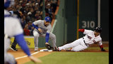 Toronto Blue Jays third baseman Brandon Drury takes a late throw as Boston Red Sox's Andrew Benintendi steals third base during the first inning of a baseball game Thursday, April 11, 2019, at Fenway Park in Boston. (AP Photo/Winslow Townson)