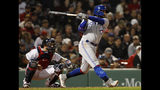 Toronto Blue Jays' Freddy Galvis follows through on his third single of the night, during the fifth inning of a baseball game against the Boston Red Sox on Thursday, April 11, 2019, at Fenway Park in Boston. (AP Photo/Winslow Townson)
