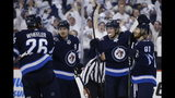 Winnipeg Jets right wing Patrik Laine (29) celebrates his goal with teammates Blake Wheeler (26), Mark Scheifele (55) and Kyle Connor (81) during the second period against the St. Louis Blues in Game 2 of an NHL hockey first-round playoff series Friday, April 12, 2019, in Winnipeg, Manitoba. (John Woods/The Canadian Press via AP)