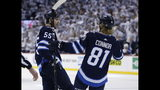 Winnipeg Jets' Mark Scheifele (55) celebrates his goal with Kyle Connor (81) during the second period of Game 2 against the St. Louis Blues in an NHL hockey first-round playoff series Friday, April 12, 2019, in Winnipeg, Manitoba. (John Woods/The Canadian Press via AP)