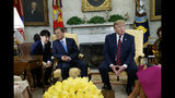 South Korean President Moon Jae-in listens to his translator as President Donald Trump speaks during a meeting in the Oval Office of the White House, Thursday, April 11, 2019, in Washington. (AP Photo/Evan Vucci)