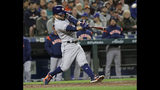 Houston Astros' Jose Altuve hits a grand slam against the Seattle Mariners during the sixth inning of a baseball game Friday, April 12, 2019, in Seattle. (AP Photo/Ted S. Warren)