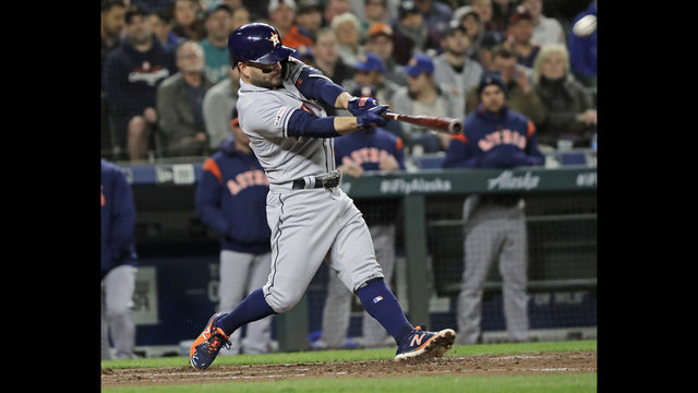 acb56d8e4 Houston Astros' Jose Altuve hits a grand slam against the Seattle Mariners  during the sixth inning of a baseball game Friday, April 12, 2019, in  Seattle.