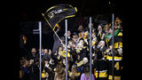 Former New England Patriots player Rob Gronkowski waves a Boston Bruins team flag before Game 2 of an NHL hockey first-round playoff series against the Toronto Maple Leafs, Saturday, April 13, 2019, in Boston. (AP Photo/Mary Schwalm)