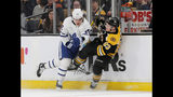 Toronto Maple Leafs left wing Trevor Moore (42) and Boston Bruins center Karson Kuhlman (83) collide along the boards during the first period of Game 2 of an NHL hockey first-round playoff series, Saturday, April 13, 2019, in Boston. (AP Photo/Mary Schwalm)
