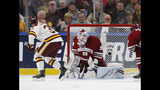 Minnesota-Duluth forward Parker Mackay (39) puts the puck past Massachusetts goalie Filip Lindberg (35) during the first period of the NCAA Frozen Four men's college hockey championship game Saturday, April 13, 2019, in Buffalo, N.Y. (AP Photo/Jeffrey T. Barnes)