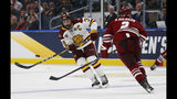 Massachusetts' Marc Del Gaizo (2) defends against Minnesota-Duluth' Parker Mackay (39) during the second period of the NCAA Frozen Four men's college hockey championship game, Saturday, April 13, 2019, in Buffalo, N.Y. (AP Photo/Jeffrey T. Barnes)