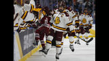 Minnesota-Duluth forward Parker Mackay (39) celebrates his goal during the first period of the NCAA Frozen Four men's college hockey championship game against Massachusetts, Saturday, April 13, 2019, in Buffalo, N.Y. (AP Photo/Jeffrey T. Barnes)