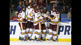Minnesota-Duluth players celebrate a goal during the second period against Massachusetts in the NCAA Frozen Four men's college hockey championship game Saturday, April 13, 2019, in Buffalo, N.Y. (AP Photo/Jeffrey T. Barnes)