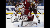 Massachusetts goalie Filip Lindberg (35) makes a save against Minnesota-Duluth during the second period of the NCAA Frozen Four men's college hockey championship game Saturday, April 13, 2019, in Buffalo, N.Y. (AP Photo/Jeffrey T. Barnes)