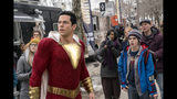 """This image released by Warner Bros. shows Zachary Levi, left, and Jack Dylan Grazer in a scene from """"Shazam!"""" (Steve Wilkie/Warner Bros. Entertainment via AP)"""