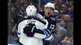 Winnipeg Jets' Brandon Tanev (13) is congratulated by teammate Andrew Copp after scoring during the third period in Game 3 of an NHL first-round hockey playoff series against the St. Louis Blues, Sunday, April 14, 2019, in St. Louis. The Jets won 6-3. (AP Photo/Jeff Roberson)
