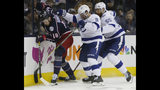 Columbus Blue Jackets' Pierre-Luc Dubois, left, keeps the puck away from Tampa Bay Lightning's Tyler Johnson, center, and Braydon Coburn during the second period of Game 3 of an NHL hockey first-round playoff series Sunday, April 14, 2019, in Columbus, Ohio. (AP Photo/Jay LaPrete)