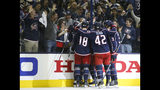 Columbus Blue Jackets' players celebrate their goal against the Tampa Bay Lightning during the second period of Game 3 of an NHL hockey first-round playoff series Sunday, April 14, 2019, in Columbus, Ohio. (AP Photo/Jay LaPrete)