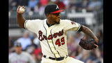 Atlanta Braves' Julio Teheran pitches against the New York Mets during the first inning of a baseball game Sunday, April 14, 2019, in Atlanta. (AP Photo/John Amis)