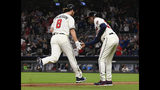 Atlanta Braves' Charlie Culberson (8) is congratulated by third base coach Ron Washington as he runs bases on his home run during the sixth inning of a baseball game against the New York Mets, Sunday, April 14, 2019, in Atlanta. (AP Photo/John Amis)