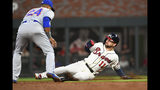 Atlanta Braves center fielder Ender Inciarte (11) steals second base with New York Mets second baseman Robinson Cano moving to attempt a tag during the second inning of a baseball game Sunday, April 14, 2019, in Atlanta. (AP Photo/John Amis)