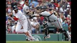 Baltimore Orioles' Jesus Sucre (40) catches Boston Red Sox's J.D. Martinez in a rundown at home plate during the fourth inning of a baseball game in Boston, Sunday, April 14, 2019. (AP Photo/Michael Dwyer)