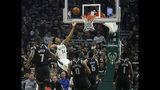Milwaukee Bucks' Giannis Antetokounmpo (34) shoots against multiple Detroit Pistons defenders during the first half of Game 1 of an NBA basketball first-round playoff series Sunday, April 14, 2019, in Milwaukee. (AP Photo/Aaron Gash)